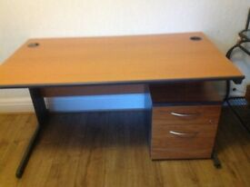 Computer desk with drawers.
