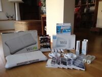 Nintendo Wii, accessories and games including Wii fit board in full working order.