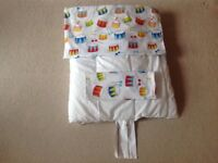 Cot duvet, with attractive cover and pillow case.