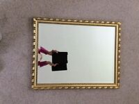 Gilt framed, antique style bevel-edged mirror