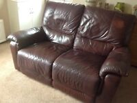 Two x 2 leather brown and recliners sofas
