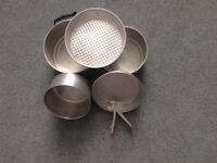 Set of Camping saucepans and frying pans with detachable handle.