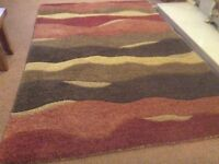 Large rug thick pile excellent condition. From pet free, smoke free home.
