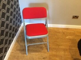 Red folding chairs x 4