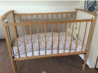 Wooden child's cot with mattress (nearly new) and bedding