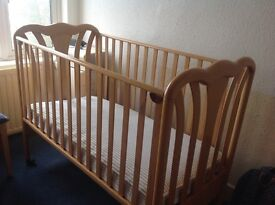 Beautiful wooden effect cot with new mattress . Perfect condition