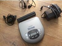 Sony Discman. Includes battery case attachment & headphone control. Plus adapter plug.