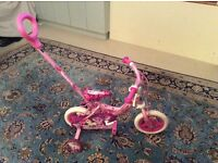 "Avigo Girls pink unicorn training bike, 10"" wheels complete with stabilisers and parents push handle"