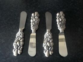 Beautiful little butter knives with pewter fruit pattern handles