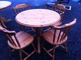 Solid pine dining table & four matching chairs in very good condition