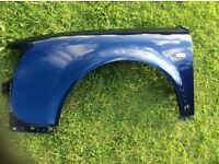 Audi A6 front wing - nearside/passenger side in blue good unmarked condition as per photo no rust