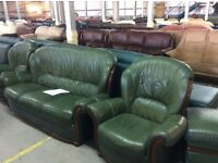 Compact green leather 3 seater & 2 chairs with footstool