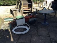 All freebies. Various garden items. Pots. Table. Hanging baskets. Pavier bricks, pond pump
