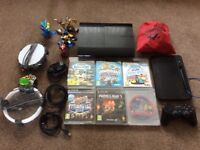 PlayStation 3 super slim with one genuine wireless controller and 6 games all in very good condition