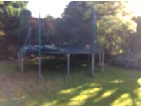 Approx 12ft trampoline with safety net.