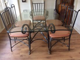 Glass topped dining table and 6 chairs