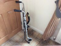 Foldable walking aid with padded seat