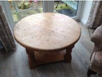 Solid heavy pine round coffee table.