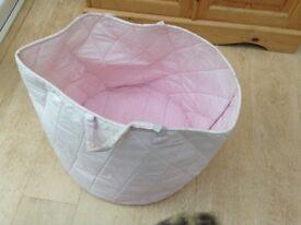Pink spotty fabric storage tub