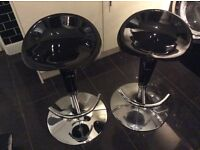 Two Vienna height adjustable black lacquer and chrome bar stools