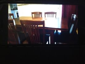 Dining table of 4 that can extend to 6 with 6 chairs
