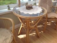 Conservatory table and two matching chairs with cushions