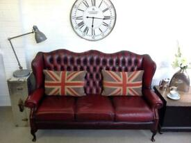 Oxblood wingback Queen Anne Chesterfield sofa. Can deliver