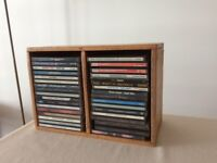 Wooden rack plus assorted CDs
