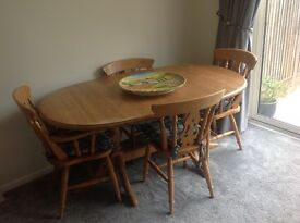 Extending pine dining table and 6 chairs £40