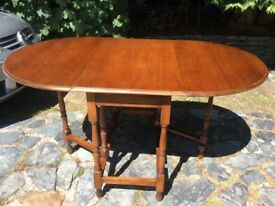 Golden oak vintage oval dinning table , gate leg ,drop leaf.