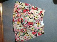 Brand new flowery mini skirt from New Look