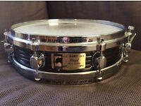 Mapex 13/3 Black Panther steel piccolo snare drum with die cast hoops.