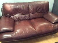 2x2 leather sofas plus a footstool