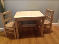 Wooden table with two chairs
