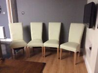 Faux leather cream dinning room chairs