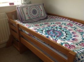 Solid wooden single bed frame with a virtually new mattress and under bed storage drawer.