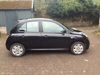 Very tiday black Nissan Micra for sale.