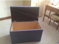 Blue fabric covered wooden ottoman