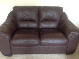 Brown leather three piece suite very good condition three seater and two seater settees and a chair.