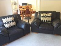 2 black leather armchairs. Modern, loungers.