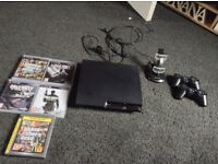 PS3 with games and accessories