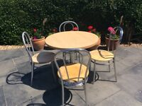 80 cm round table with four chairs.
