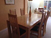 Solid wood dining table and 6 chairs.Excellent condition .Modern chairs,faux leather seats.bargain!
