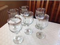 6 wine glasses. Silver rims, very good condition