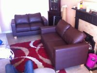 2 brown leather sofas good condition