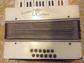 Very old piano accordion it will need some repairs but still works.