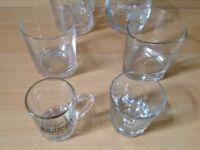 Six whiskey glasses branded.