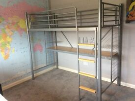 Single aluminium high bed, with desk underneath.