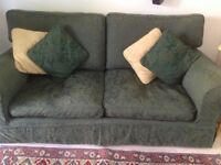 Green 3 seater sofa with cushions