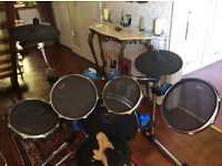 Traps practise drum set in good condition, although small hole in base drum . No base pedal